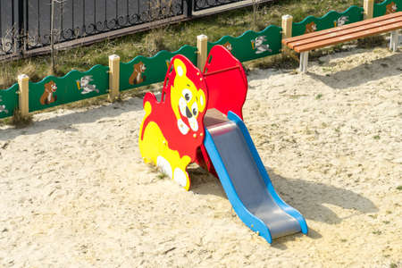 Children's slide in a playground Banco de Imagens - 125354335