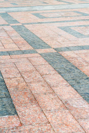 Natural stone laid on the pavement with a pattern. Natural stone laid on the pavement with a pattern.