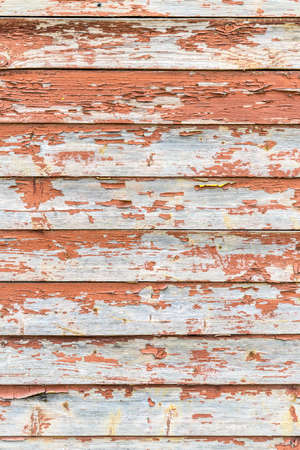 Old wood painted red. The paint will get off the wood. Background Banco de Imagens - 125354433