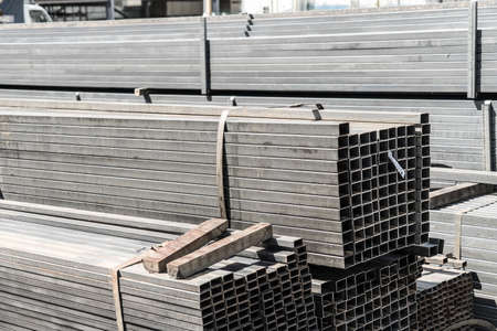 Metal square pipe. Sale of metal pipe. Metal square pipe. Sale of metal pipe. Banco de Imagens