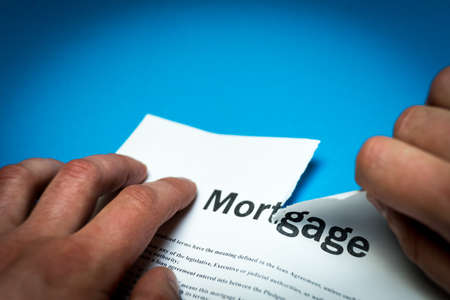 A broken mortgage contract. Photo of the document. A broken mortgage contract. Photo of the document.