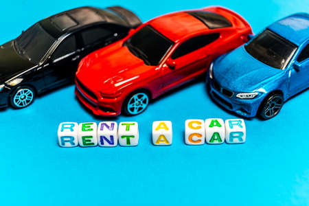 Photo toy cars. The inscription to rent a car. Photo toy cars. The inscription to rent a car. Banco de Imagens - 125355710