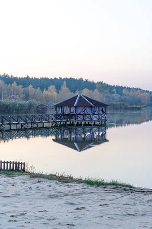 gazebo on the water. photo of a spacious gazebo in the country.