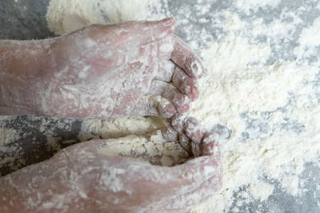 Hands in flour. Homemade cake. Cooking in the kitchen. Hands in flour. Homemade cake. Cooking in the kitchen.