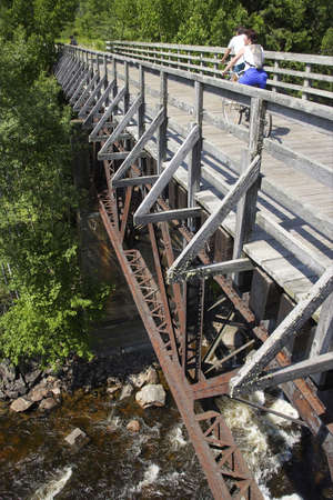 Old train bridge. Now is part of bicycle route. Quebec, Canada photo