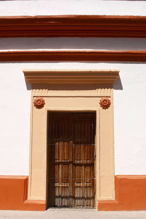 front view of a typical colonial door in the town of Alamos in the northern state of Sonora, in Mexico, Latin America photo