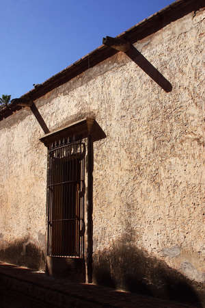 sonora: Typical colonial wall with window in the town of Alamos in the northern state of Sonora in Mexico, Latin America