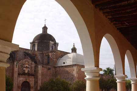 sonora: view of the roof of the church from the colonial archway in the town of Alamos in the northern state of Sonora, Mexico, Latin America