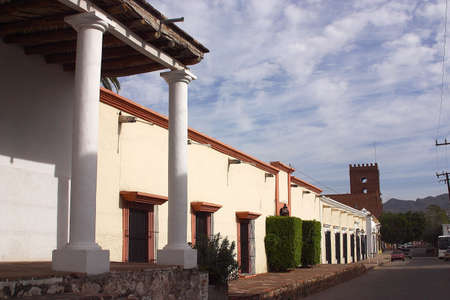 sonora: general view of a street, sidewalk and colonial houses in the centre of the town of Alamos in the northern state of Sonora, Mexico, Latin America Stock Photo