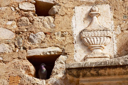 sonora: detail of the wall of stone with a niche and a dove inside in the town of Alamos, in the northern state of Sonora, Mexico, Latin America Stock Photo