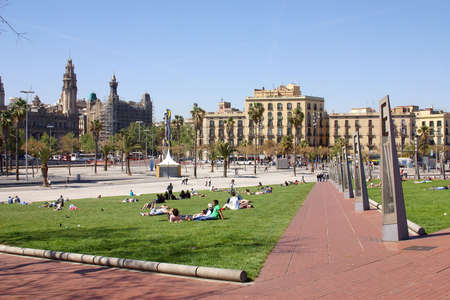 catalunya: park at the waterfront with people  at the city of Barcelona, Catalunya, Spain, Europe