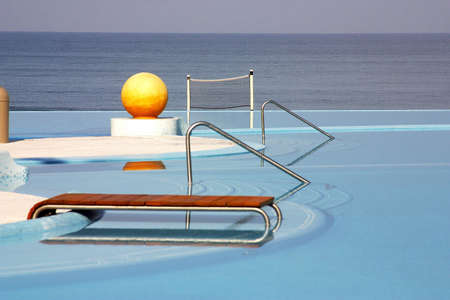 partial view of the pools of a hotel with a yellow ball and the ocean behind in Puerto Vallarta, Jalisco, Mexico, Latin America