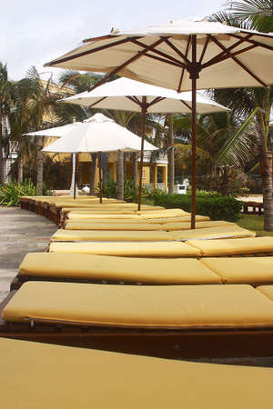 roo: relaxing beach chairs in a hotel with hacienda like details in Cancun, Riviera Maya, Quinatan Roo, Mexico, Latin America Stock Photo