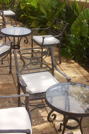 roo: tables and chairs in the garden of a hotel with hacienda like details in Cancun, Riviera Maya, Quinatan Roo, Mexico, Latin America