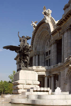 Partial view of the entrance door of the Palace of Fine Arts and the sculpture and fountain in front of it in Mexico city, Latin America Stock Photo