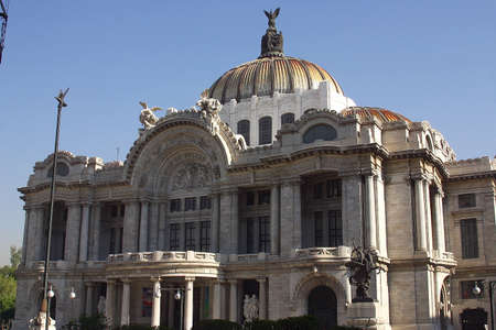 front view of the marble construction of the Palace of Fine Arts with partial view of the gardens and fountains in front, down town Mexico city, Mexico Latin America Imagens