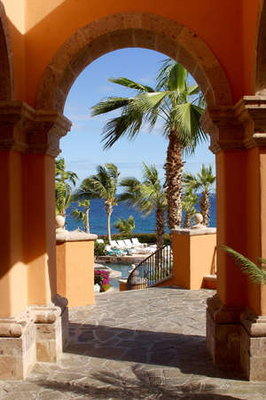 archway: partial view from an archway of the pools of a hotel at Los Cabos, Baja California, Mexico, Latin America