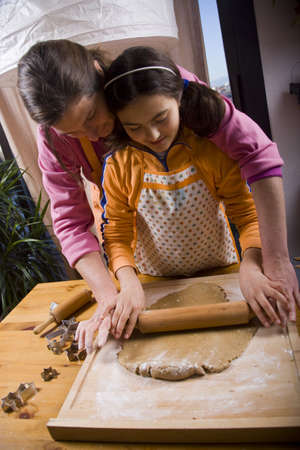 backing: Cooking homemade cookies in Christmas even Stock Photo