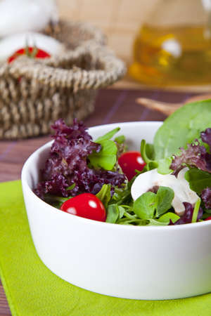 dinnertime: a detail of a organic salad at home