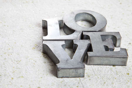 love sign made with metal elements Imagens
