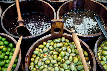 Sales of traditional products -Mediterranan olives- in the market and selected market Viktualienmarkt, Munich, Germany photo