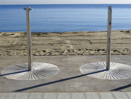 showers: Two showers in the beach of Barceloneta, Barcelona, Spain
