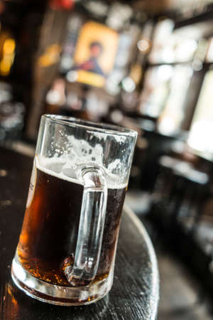Beer glass in a pub photo