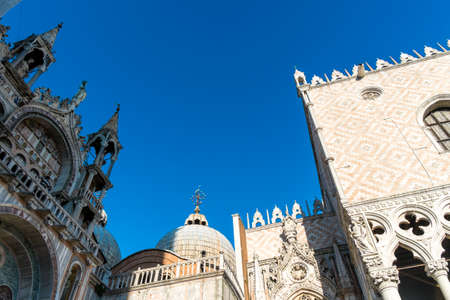 marco: Cathedral of San Marco (San Marco basilica) in Venice, Italy with seagull flying above in the sky. View from San Marco square. Architecture postcard background.