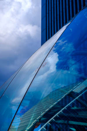 sky reflection: Close-up of glass surface with building reflection against of cloudy sky