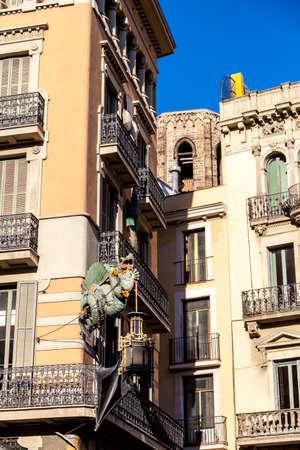 rambla: Barcelona. Chinese dragon on House of Umbrellas (Casa Bruno Cuadros) building on La Rambla. Catalonia, Spain.
