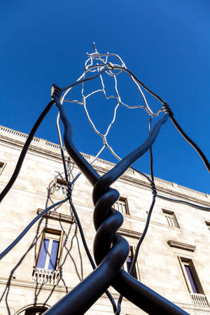 Barcelona, Spain - February 16, 2012: Castellers human tower modern statue at Placa de Sant Miquel Editöryel