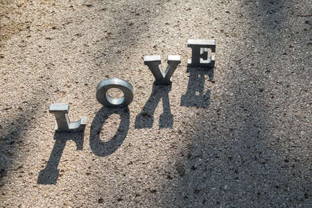 metal letters: message of love with metal letters in a road