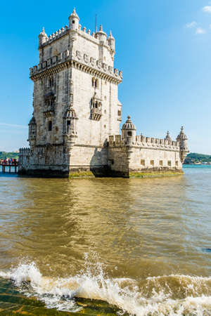 descubridor: Torre of Belem at sunset, famouse landmark of Lisbon, Portugal, retro toned Editorial