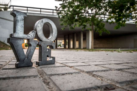 love icon: Love sign with metal letters in a street of Spain Stock Photo