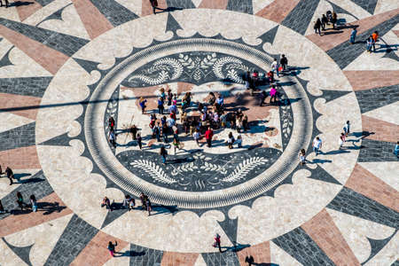 lisbonne: Lisbon, Portugal - April 18, 2014: The mosaic map of the Portuguese maritime discoveries at the monument to Pioneers. District of Belem in Lisbon