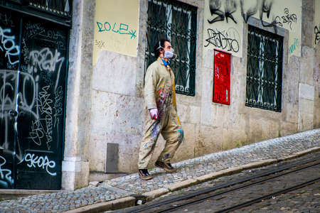 street art: Lisbon, Portugal - April 16, 2014: Street artist in Lisbon Portugal