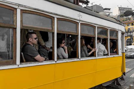 28: Lisbon, Portugal - April 16, 2014: Classic vintage tram route 28 in Alfama district in Lisbon Portugal