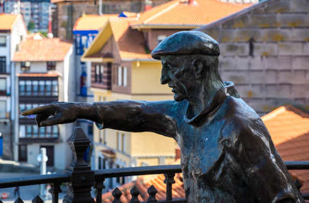 oudoor: Bermeo, Basque Country, Spain - July 26, 2016: sculpture of a fisherman in the coast of Basque Country