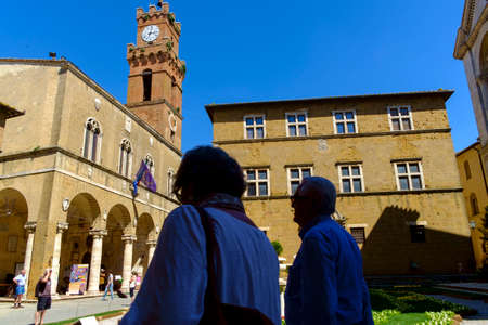 Pienza, Italy - May 9, 2014: tourism at Piazza Pio II square  in Pienza Tuscany Italy Europe  Piazza Pio II square  in Pienza Tuscany Italy Europe