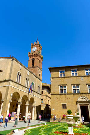 Pienza, Italy - May 9, 2014: tourism at Piazza Pio II square  in Pienza Tuscany Italy Europe  Piazza Pio II square  in Pienza Tuscany Italy Europe Banco de Imagens - 77203726
