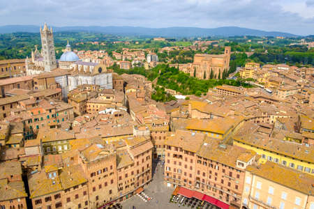 Siena, Italy - May 11, 2014:  The Duomo and Campanile view from the Torre del Mangia of Palazzo Pubblico  Siena, Tuscany, Italy