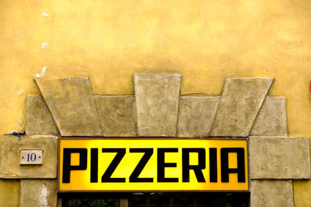 Siena, Italy - May 11, 2014: Pizzeria sign in the downtown streets of the city
