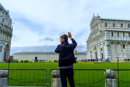 Pisa, Italy - May 11, 2014:  Piazza dei Miracoli with tourist in a spring day
