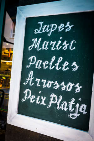 Restaurant menu with spanish and catalonian dishes in Barcelona Catalonia Spain Stock Photo
