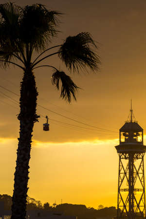 catalunya: Cable-Car at the popular beach of Barceloneta during the sunset Mediterranean coast Europe Stock Photo