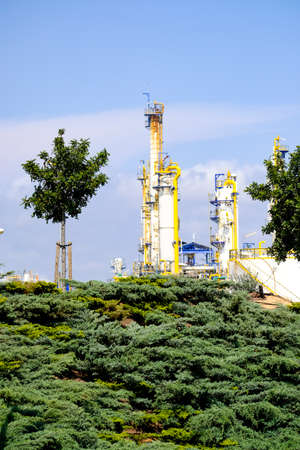 Reforestation in the surroundings of a petrochemical complex in Europe Stock Photo