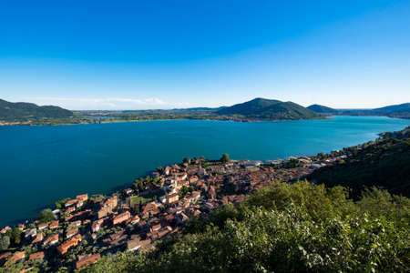 Panoramic view of the Predore village from the Madonna della Neve Sanctuary in San Gregorio on Lake Iseo in Lombardy in northern Italy