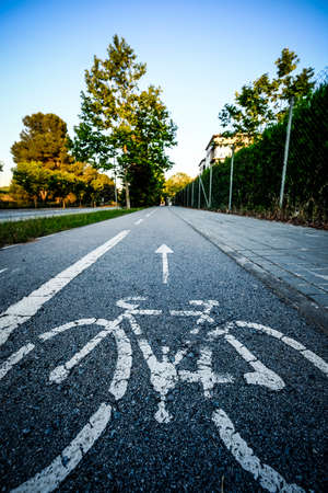 Special bicycle path next to an urban park in the city of Sant Cugat del Valles, one of the urban centers with the best growth in quality of life in the province of Barcelona Reklamní fotografie