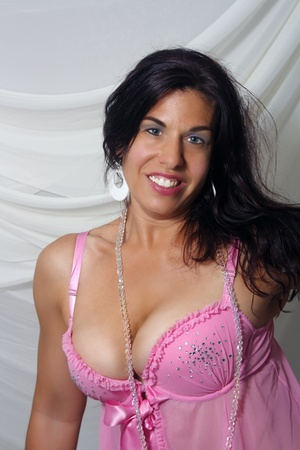 Close-up of a lovely woman with a bright, warm smile, wearing pink lingerie Stock Photo - 10341261