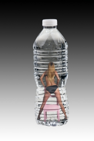 A lovely blonde wearing midnight-blue panties and bra, standing stradle on a pink, wooden chair with her back to the camera,inside a bottle of water. photo